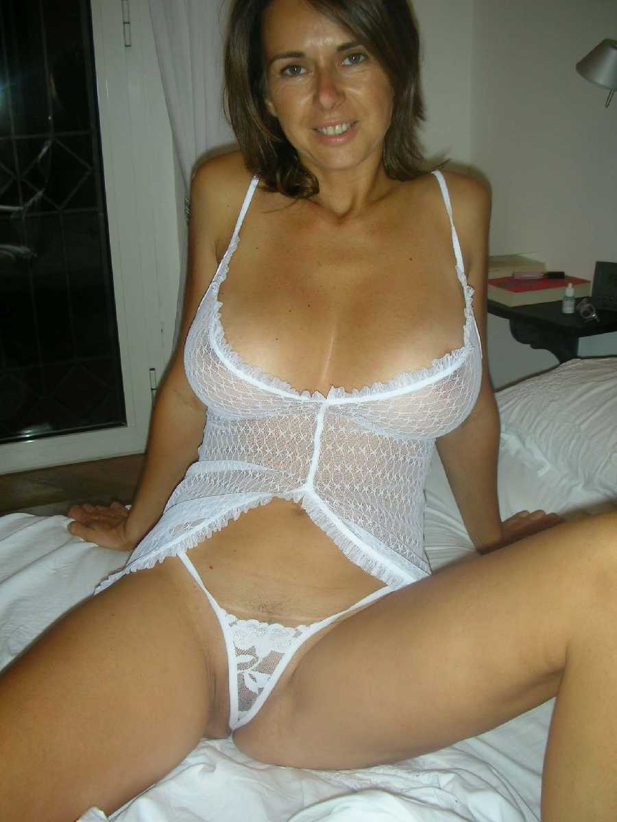 Moms With Big Tits A Hot Looking Mom Is On The Bed Ready For Some Fun